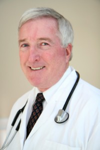 male physician in white coat with stethoscope