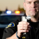 police officer showing DWI test device - error rate