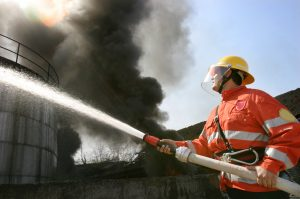 fire fighter spraying water